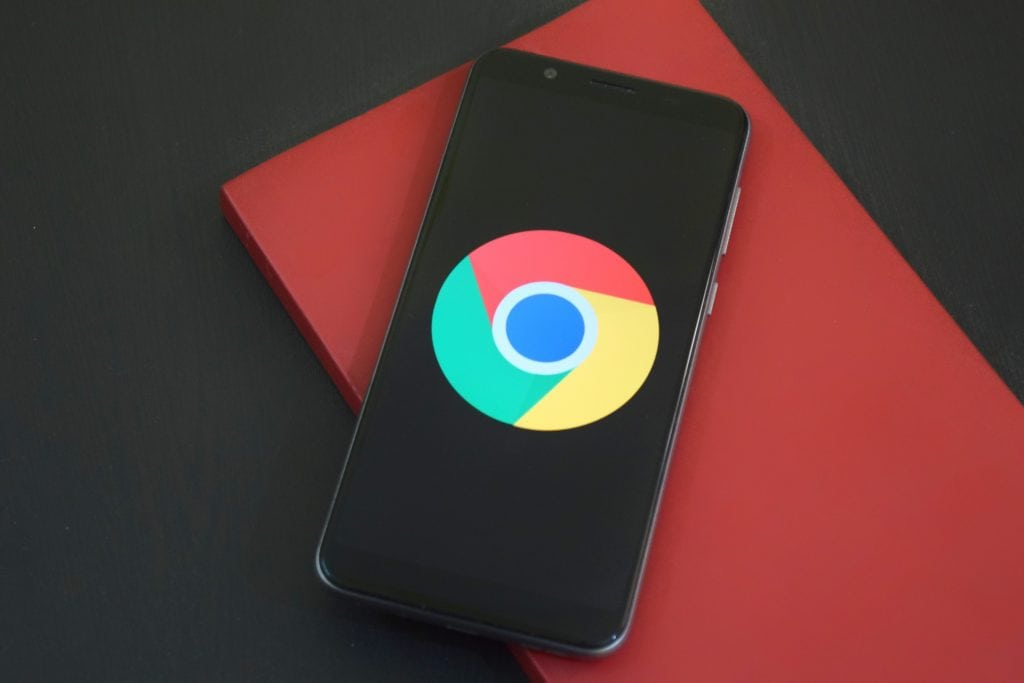 an android phone with a google chrome logo on the screem
