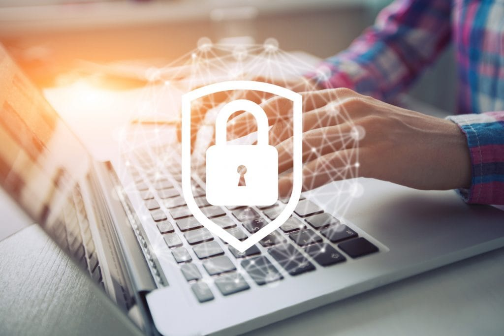 Network security icon with person on laptop