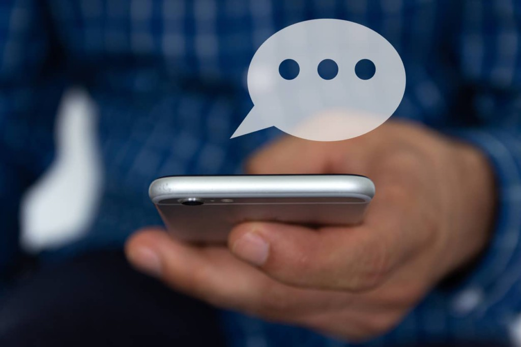 Hand of man typing text on mobile smartphone. Online chat chatting on application communication digital media website and social network.