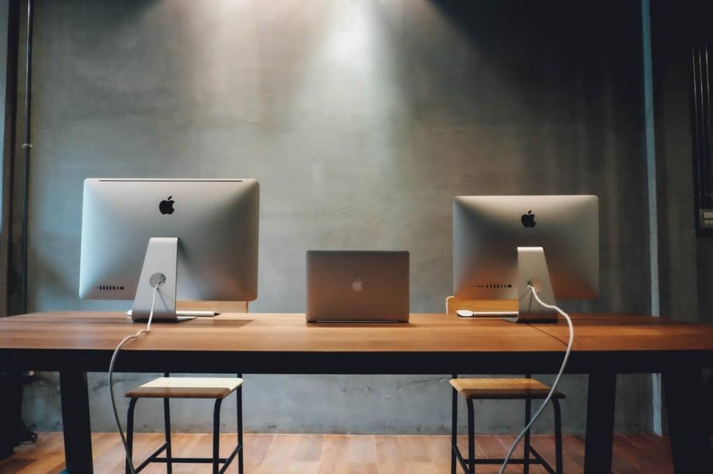 work desktops and laptops on a desk