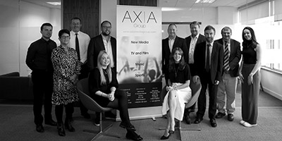 Black and white photo of Axia team